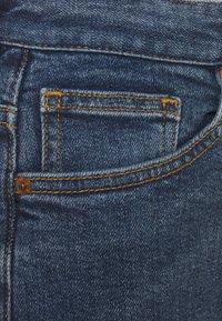 Monki - ZAMI LA LUNE - Straight leg jeans - blue medium dusty - 5