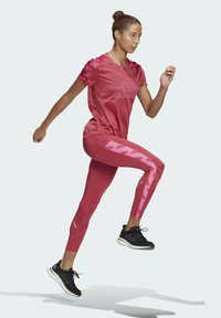 adidas Performance - OWN THE RUN CELEBRATION RUNNING LANGE TIGHT. - Leggings - pink - 1