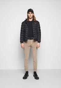 HUGO - Trousers - light pastel brown - 1