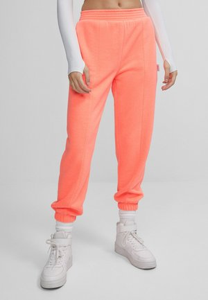 LENTICULAR - Tracksuit bottoms - orange