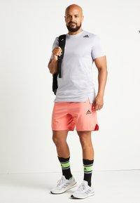 adidas Performance - Sports shorts - seflre - 2