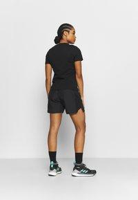 adidas Performance - TERREX PRIMEBLUE TRAIL - Sports shorts - black - 2