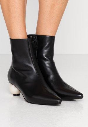 ROXY - Kotníkové boty - black