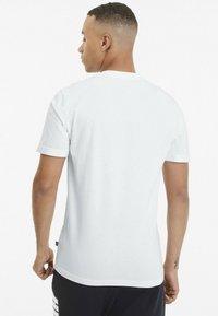 Puma - REBEL BOLD  - T-shirt con stampa - puma white/puma black - 1