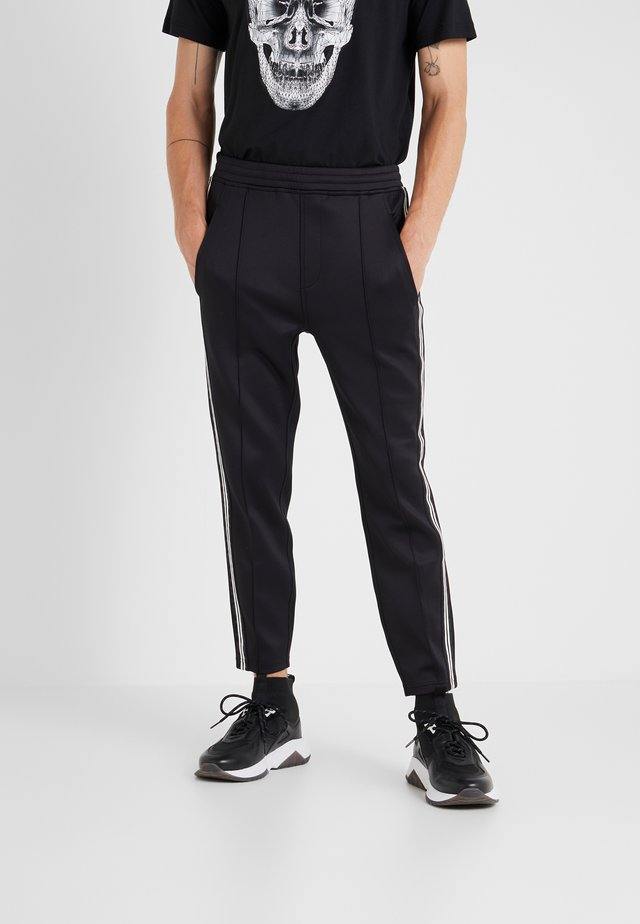 LOGO TAPE - Tracksuit bottoms - black/white