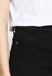 ONLY - ONLRAIN SWEET - Flared Jeans - black - 3