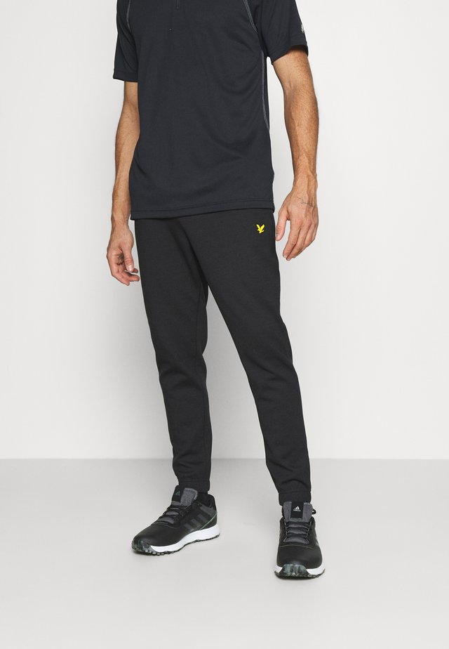GOLF TRACK PANTS - Trousers - true black