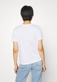 Calvin Klein - ZEBRA PRINT FILLED LOGO REGULAR FIT TEE - Print T-shirt - white - 2