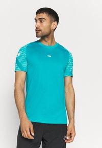 Nike Performance - Print T-shirt - aquamarine/tropical twist/white - 0