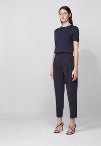 BOSS - TAPIA - Trousers - open blue - 1