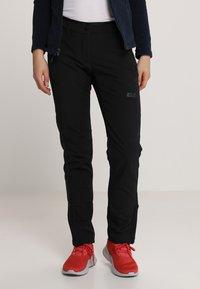 Jack Wolfskin - ZENON PANTS WOMEN - Outdoorové kalhoty - black - 0