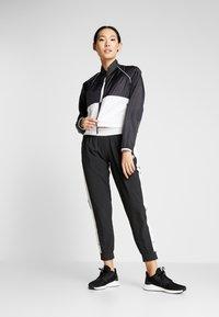 New Balance - VELOCITY JACKET - Sports jacket - black/white - 1