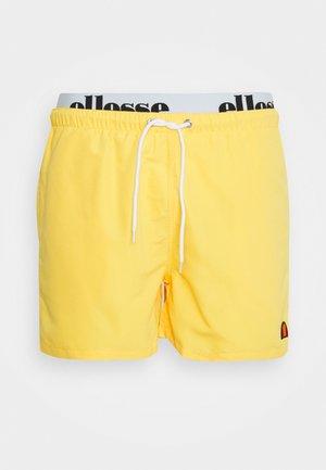 TEYNOR - Swimming shorts - yellow