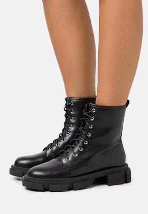 MARTA - Platform ankle boots - black