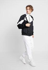 Nike Sportswear - Kurtka sportowa - black/summit white - 1