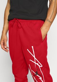 Jordan - AIR THERMA PANT - Trainingsbroek - gym red/black - 4