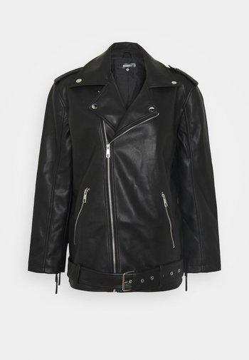 FRINGE BACK BIKER - Faux leather jacket - black