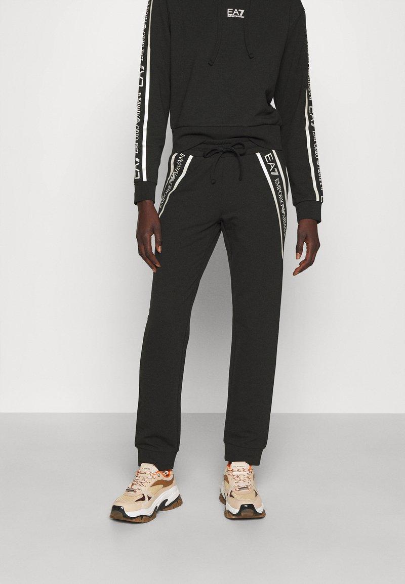 EA7 Emporio Armani - Pantalones deportivos - black/white