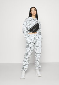 Missguided - PLAYBOY LOGO JOGGER - Tracksuit bottoms - grey marl - 1