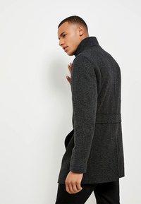 Next - FUNNEL NECK ZIP THROUGH COAT - Short coat - black - 2
