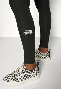 The North Face - HIGH WAISTED - Leggings - black - 6