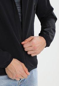 Haglöfs - NATRIX HOOD MEN - Soft shell jacket - true black - 5