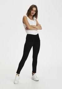 Culture - Leggings - Trousers - black - 1