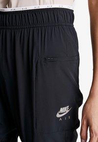 Nike Performance - AIR PANT - Joggebukse - black - 4