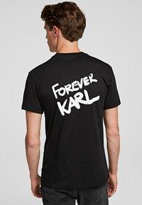 KARL LAGERFELD - FOREVER  - Print T-shirt - black - 1