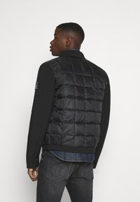 Calvin Klein Jeans - MOTO JACKET - Light jacket - black - 2