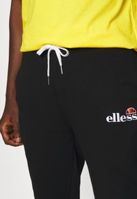 Ellesse - NIORO - Tracksuit bottoms - black - 5