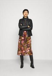 Liu Jo Jeans - IMBOTTITO OVATT CORT - Faux leather jacket - nero - 1