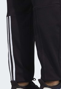 adidas Performance - MUST HAVES AEROREADY TRACKSUIT BOTTOMS - Tracksuit bottoms - black - 4