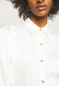 DESIGNERS REMIX - EMME SLEEVE - Button-down blouse - cream - 9
