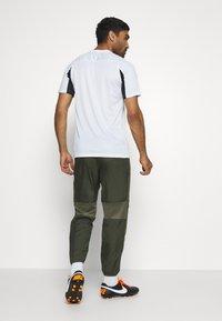Nike Performance - DRY ACADEMY PANT - Tracksuit bottoms - cargo khaki/medium olive/white - 2