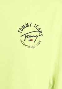Tommy Jeans - LOGO TAPE TEE DRESS - Day dress - faded lime/multi - 7