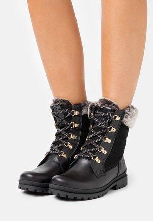 TUSCANI - Šněrovací kotníkové boty - black