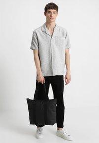 Rains - TOTE BAG RUSH - Shopping bags - black - 1
