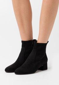 Unisa - LEZAMA - Classic ankle boots - black - 0