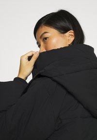 Calvin Klein Jeans - ECO PUFFER JACKET - Vinterjakke - black - 4