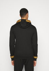 EA7 Emporio Armani - Zip-up hoodie - black/gold - 2