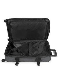 Eastpak - TRANS4 L CORE COLORS REISEGEPÄCK - Wheeled suitcase - black denim - 3
