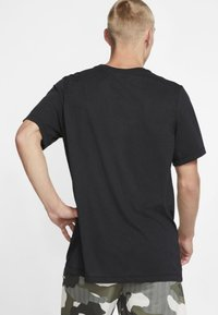 Nike Performance - DRY TEE PRO - Camiseta estampada - black