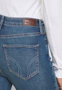 Hollister Co. - CURVY MED SHRED - Jeans Skinny Fit - blue - 4