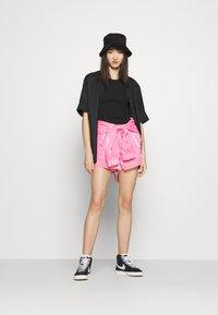 Nike Sportswear - AIR SHEEN - Shorts - pink glow/black - 1