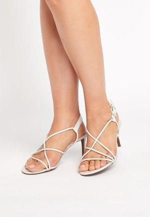 BLACK STRAPPY SANDALS - Sandals - white
