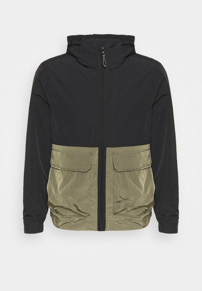 Calvin Klein - CRINKLE HOODED WINDCHEATER - Summer jacket - green