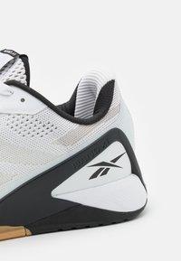 Reebok - NANO X1 - Sports shoes - white/black - 5