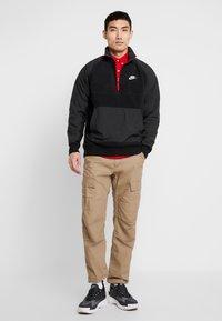 Nike Sportswear - WINTER - Fleecetrøjer - black/off noir/gym red/white - 1