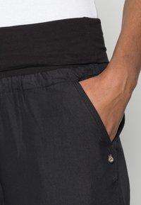 Cream - LINE PANTS - Trousers - solid black - 4